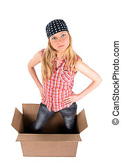 Girl standing in a cardboard box, looking up. Isolated on white.