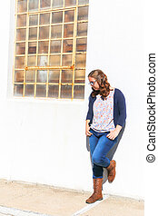 Girl Leaning Against Wall
