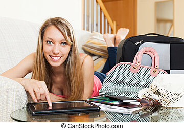 Girl on couch near baggage