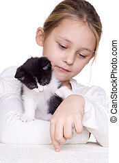 girl plays with a kitten