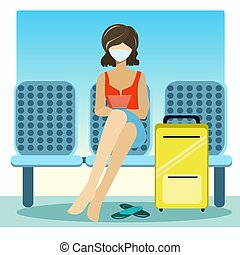 Girl sitting in a waiting room with a suitcase