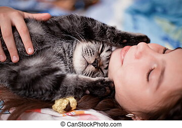 Girl with a gray tabby kitten