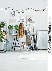 Girl working in home office