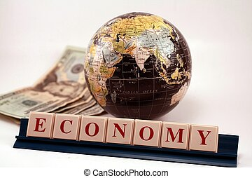 A world globe with United States money and market economy against a white background. Business, financial and world trade. Global trade, financing and business.