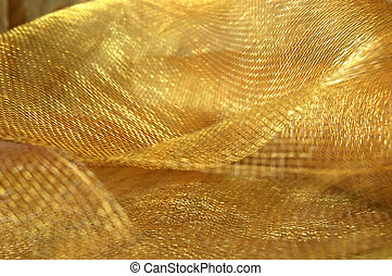 Shiny gold netting fabric used for holiday decorating.