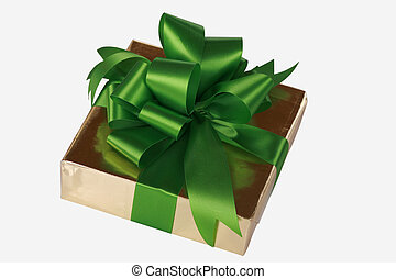 Gold present wrapped with green ribbons