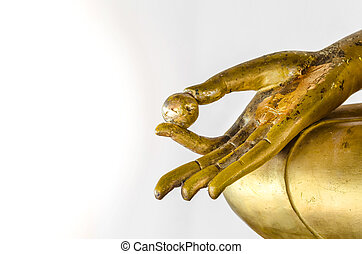 Golden Buddha statue in hand isolated on white background.