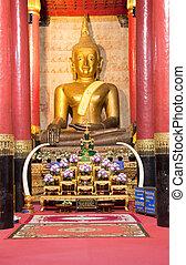 Golden Buddha statue on night at Northern, Thailand.