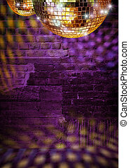 Golden mirror balls reflect lights on dramatic dark disco brick wall