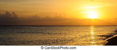 Golden sunrise sunset over the sea ocean.