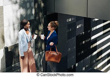 Gossiping businesswomen