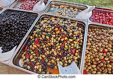 gourmet assortment of pickled olives in italian market