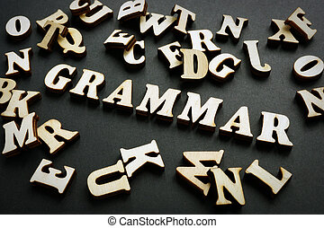Grammar word from wooden letters. Learn English concept.