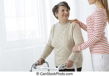 Granddaughter helping her grandma