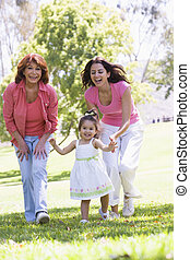 Grandmother with adult daughter and granddaughter in park