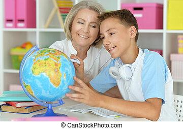 granny with grandson doing homework