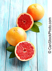 Grapefruit fruits on a blue wooden table