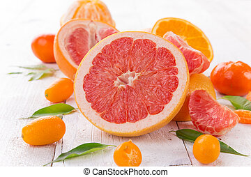 Grapefruit on a wooden table.