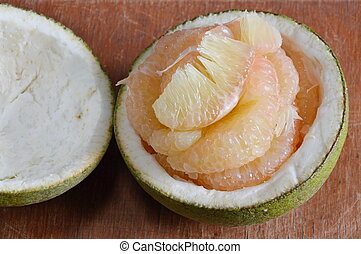 grapefruit on wooden table