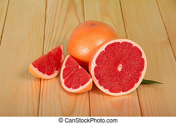 Grapefruits on wooden table
