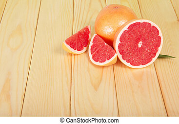 Grapefruits segments on a wooden table