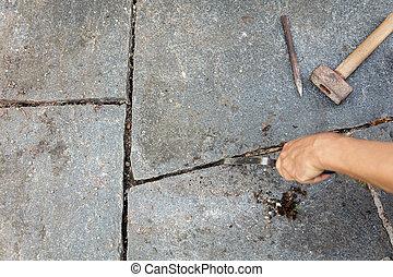 grey flagstones with stone mason tools