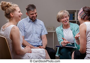 Picture of support group during meeting with professional therapist