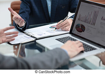 Group of business people busy discussing financial matter during