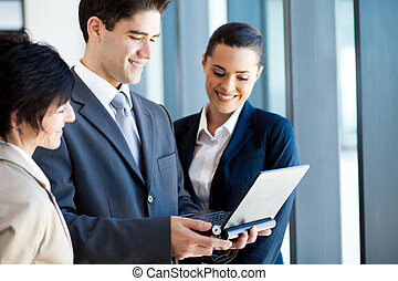 group of business people using laptop