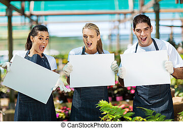 nursery workers with white board