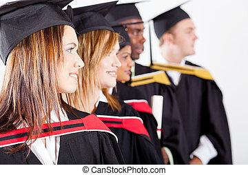 graduates looking away at graduation