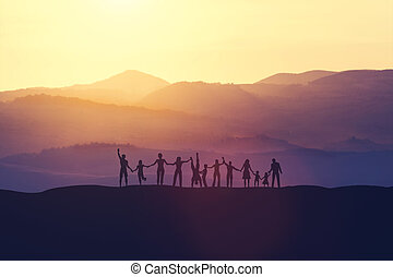 Group of happy people at sunset