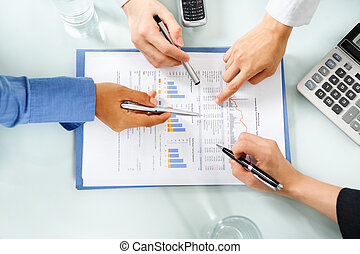 group of people examining economic booming statistic