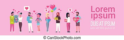 Group Of People Holding Presents On Template Pink Background Valentine Day Holiday Concept