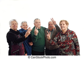 Group of senior people with victory sign