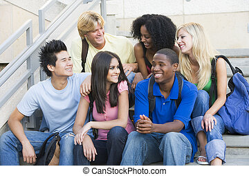 Group of six students sitting on outside on stairs