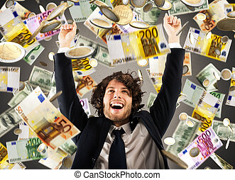 Happy businessman under a rain of money