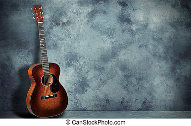 Guitar on grunge wall background