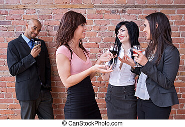 Guy looking at girls drinking wine
