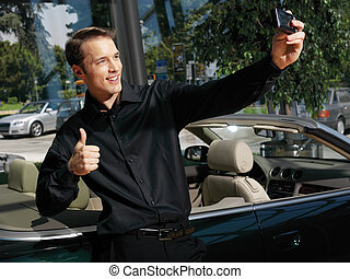 guy taking photo with cellphone a