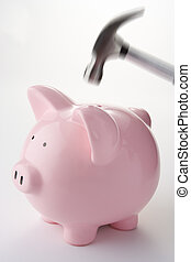 Hammer Aiming For Piggy Bank