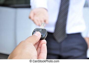 Hand giving a car key