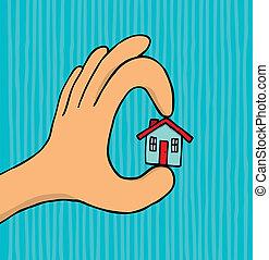Hand holding tiny house