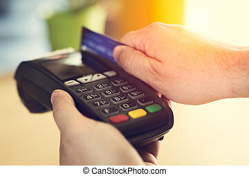 Hand Swiping Credit Card In Store