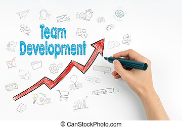 Hand with marker writing - Team Development, Business Concept