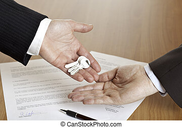 Handing over the keys after contract signing