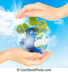 Hands and Earth. Concept Save green planet. Symbol of environmental protection.