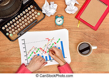 hands drawing stock chart