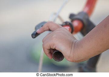 Hand's little girl and bicycle handlebar