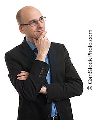 handsome bald man thinking and looking up. Isolated